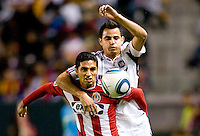 Mariano Trujillo defender of the Chivas USA and Chicago Fire midfielder Marco Pappa battle for a loose ball. The Chicago Fire defeated CD Chivas USA 3-1 at Home Depot Center stadium in Carson, California on Saturday October 23, 2010.