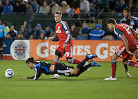 Chris Wondolowski (8) falls on the dribble after a push from Adrian Cann (12). The San Jose Earthquakes tied Toronto FC 1-1 at Buck Shaw Stadium in Santa Clara, California on April 9th, 2011.