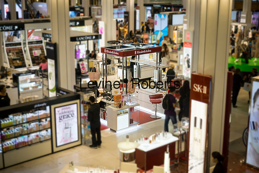 The Elizabeth Arden boutique within Macy's department store in Herald Square in New York on Friday, June 17, 2016. Revlon announced that it is buy rival Elizabeth Arden in an $870 million deal. The combined companies will have sales in the $3 billion range. (© Richard B. Levine) Photo illustration.