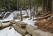 "Diana's Bath in Bartlett, New Hampshire USA during the winter months. Diana's Baths is a series of small cascades located along Lucy Brook. Remnants of the old 1800s ""Lucy's Mill"" can be seen in the foreground. The Lucy family owned this sawmill, and they abandoned it in the 1940s."