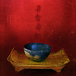 An ancient bowl worn with time and the Chinese characters for: wisdom happiness, longevity, and fortune. Photo based mixed medium image. Extreme grain and texture with soft qualities. Prints beautifully.