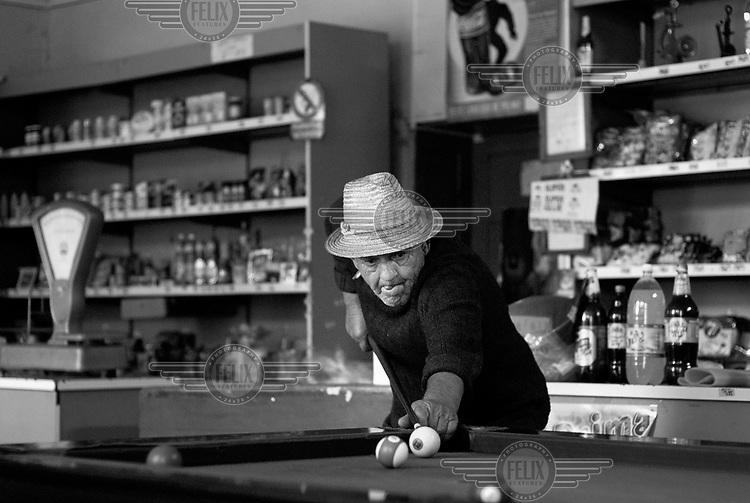 A man plays pool at a local pub, Bistrita.