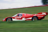 Hans Stuck drives a Porsche 962 during the 1986 IMSA GTP race at Mid-Ohio Sports Car Course near Lexington, Ohio.