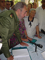 Photo File/ HAVANA, CUBA NOVEMBER 11, 2002:<br /> President Fidel Castro and an American group led by U.S. Rep. James McGovern, a Massachusetts Democrat, signed an agreement Monday to collaborate on the restoration and preservation of 2,000 letters, 3,000 personal photographs and some draft fragments of novels and stories that were kept in the humid basement of Finca de Vigia, the villa outside Havana where Hemingway lived from 1939-1960. Funded by the Rockefeller Foundation, the joint effort by the New York-based Social Science Research Council and the Cuban National Council of Patrimony will produce mircofilm copies of the material, restore some documents damaged by the Caribbean climate, and help conserve the house, including a 9,000-volume library and Hemingway's fishing boat, El Pilar. Credit: Jorge Rey/MediaPunch
