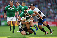 Chris Henry of Ireland is tackled to ground. Rugby World Cup Pool D match between Ireland and Romania on September 27, 2015 at Wembley Stadium in London, England. Photo by: Patrick Khachfe / Onside Images