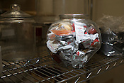 A jar of saved ast food condiments in the kitchen area of Galaxy Cinema, Cary, Sat., Jan. 12, 2013.