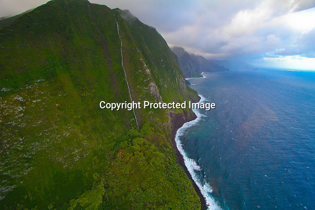 3,000 foot tall sea cliffs on the coast over the beaches of Molokai, Hawaii. Photo by Jim Urquhart/Straylighteffect.com