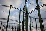 Empty rigid-design gas holders architecture at the Oval, South London.