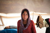 ARBAT, IRAQ: Khetam Maha, 12, pictured in a refugee camp on the outskirts of Arbat in the semi autonomous region of Iraqi Kurdistan. ..Refugees from Syria, most of whom are Kurds, have been arriving at camps in Kurdistan trying to escape the continuing conflict.  Arbat is located approximately 20 kilometres away from Sulaimaniyah...Photo by Ali Arkady/Metrography.