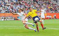 Lauren Cheney (l) of team USA and Diana Ospina of team Colombia during the FIFA Women's World Cup at the FIFA Stadium in Sinsheim, Germany on July 2nd, 2011.