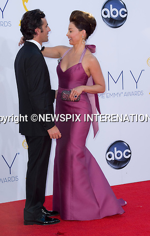 """ASHLEY JUDD AJDUSTS HUSBAND DARIO's LOOKS - 64TH PRIME TIME EMMY AWARDS.Nokia Theatre Live, Los Angelees_23/09/2012.Mandatory Credit Photo: ©Dias/NEWSPIX INTERNATIONAL..**ALL FEES PAYABLE TO: """"NEWSPIX INTERNATIONAL""""**..IMMEDIATE CONFIRMATION OF USAGE REQUIRED:.Newspix International, 31 Chinnery Hill, Bishop's Stortford, ENGLAND CM23 3PS.Tel:+441279 324672  ; Fax: +441279656877.Mobile:  07775681153.e-mail: info@newspixinternational.co.uk"""