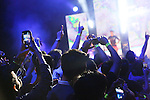 Fans with mobile telephones at the ready wait as the MMA stars make their theatrical entrance<br />