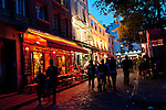 Editorial Travel Photography: Tourists enjoying the Terraces of Place du Tertre in Montmartre, Paris, France