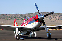 The 2008 Gold Unlimited Champion 'Strega,' piloted by Bill 'Tiger' Destafani sits on the ramp at Stead Field Nevada after finishing first in the 2008 Unlimited Gold Finals. Strega, a modified North American Aviation P-51D Mustang powered by a Rolls Royce Merlin engine, finished 1st for the seventh time in its illustrious career.