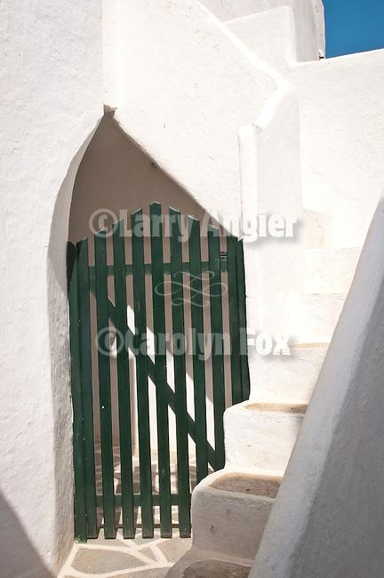 Dark green gate, half-arch and steps, Folegandros, Cyclades, Greece