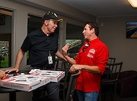 Sep 3, 2016; Clermont, IN, USA; Papa Johns pizza founder John Schnatter (right) talks with NHRA president Peter Clifford qualifying for the US Nationals at Lucas Oil Raceway. Mandatory Credit: Mark J. Rebilas-USA TODAY Sports