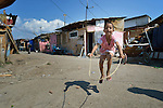 """THIS PHOTO IS AVAILABLE AS A PRINT OR FOR PERSONAL USE. CLICK ON """"ADD TO CART"""" TO SEE PRICING OPTIONS.   A boy skips rope in Suto Orizari, Macedonia. The mostly Roma community, located just outside Skopje, is Europe's largest Roma settlement. ."""