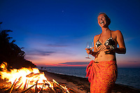 Long Caye, Lighthouse Reef, Belize, May 2012. Ruth Devacht, owner of Huracan diving at the bonfire on the beach with her guests. The island of Long Caye is located roughly 20 minutes south of the blue hole and 5 minutes from Half Moon Caye. Half of Long Caye is undisturbed jungle and mangrove, while the other half is the lush geen home to Huracan Diving and Itza resort.  Photo by Frits Meyst/Adventure4ever.com