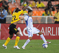 El Salvador midfielder Cristian Castillo (12) goes against Jamaica midfielder Damion Williams  (22)  Jamaica defeated El Salvador 2-0 in a international friendly match at RFK Stadium, Wednesday August 15, 2012.