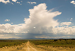 Dirt road from Chaco; storm on the horizon, New Mexico
