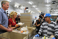 Phoenix, Arizona -- Actress Pamela Anderson talks to a jail inmate who works at the facility processing foods. Anderson visited the Lower Buckeye County Jail in Phoenix, Arizona to promote all-vegetarian meals for inmates. Anderson visited the detention facilities as a spokesperson for People for the Ethical Treatment of Animals (PETA). The actress was given a tour of the facilities by Maricopa County Sheriff Joe Arpaio.  Anderson was accompanied by PETA Senior Vice President Dan Mathews. Photo by Eduardo Barraza © 2015