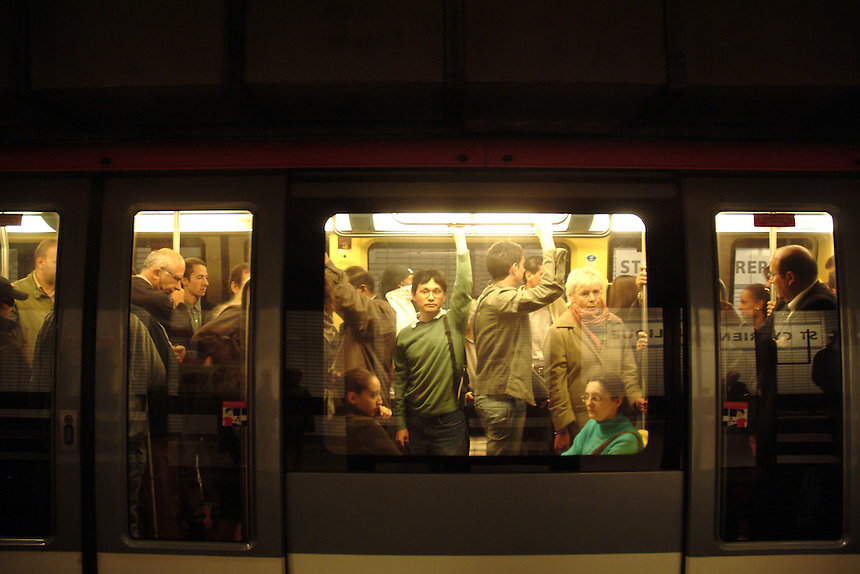 Commuters on subway in Toulouse, France.