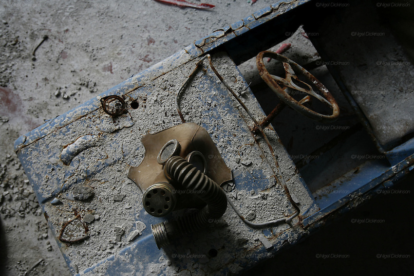 Chernobyl, Exclusion Zone, Ukraine. Gasmask and toy car the  floor in  the Maternity Hospital. Pripyat Town built 15 years before the Chernobyl reactor fire. The whole town was evacuated shortly after. The  Chernobyl Reactor, towns, plant and environs just before the 20th anniversary of the nuclear disaster.