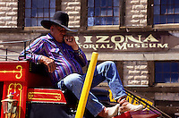 cowboy on red horse carriage. A tough looking cowboy on top of his reed horse wagon in Tombstone foto, reise, photograph, image, images, photo,<br />