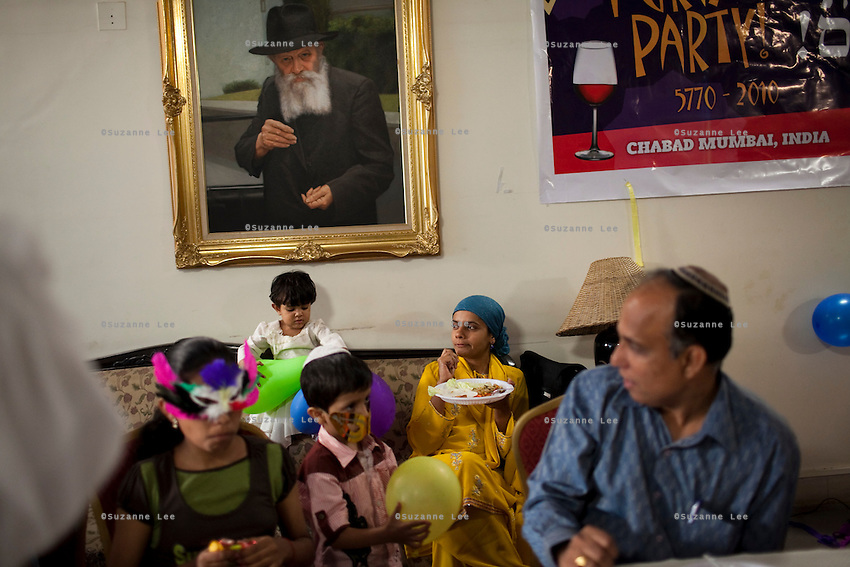 Guests and yeshivas eat and play games during the Purim party at Chabad Mumbai, India. Photo by Suzanne Lee for Chabad Lubavitch
