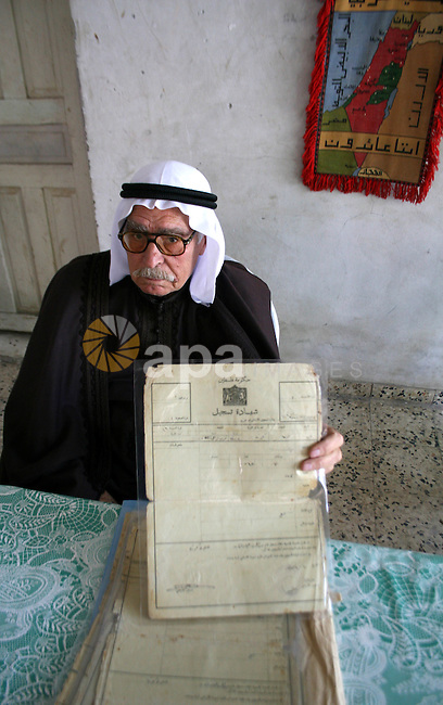 An elder palestinian refugee Abu Mahmoud El-Khaldi ,82, holds his lost house ownership documents inside 48 lands, at El-Shateaa refugee camp, in Gaza City.  Palestinian refugees still dream to come back to their houses inside the green line which occupied by Israel in 1948 , as they set to mark the sixtieth anniversary of the catastrophe (Israel foundation) on May 15. The United Nations is set to halt delivery of humanitarian aid to the Gaza Strip today because its vehicles have run out of fuel, a UN official said..