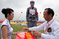 Senior officials present event winners with medals and winners cheques at the Red Games. Held in Junan County, this sporting event is a nostalgic tribute to the communist era.