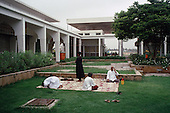 Salalah, Oman.July 2001..Men pray behind a mosque.