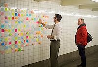 "Matthew Chavez adjusts the post-it notes that travelers have been writing their thoughts on the results of the presidential election as part of the ""Subway Therapy"" project in the subway in New York, seen on Tuesday, November 15, 2016. Chavez started the project to enable New Yorkers to vent their emotions on the election of Donald Trump. Many wrote angry messages and some wrote messages of hope and some now felt they were not alone and part of a community. (© Richard B. Levine)"