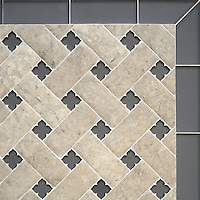 Fraser, a stone waterjet mosaic, shown in Palomar Venetian honed and Warm Grey glass flowers with honed Warm Grey glass bricks, is part of the Altimetry Collection for New Ravenna.