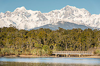Bridge over Gillespies Lagoon with great views of Mt. Cook and Mt. Tasman,  Westland National Park, West Coast, World Heritage Area, South Westland, New Zealand