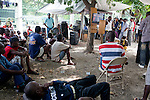 People crowd around several television sets to watch Spain play the Netherlands in the World Cup final on July 11, 2010 in Port-au-Prince, Haiti.