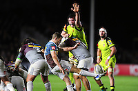 Charlie Mulchrone of Harlequins box-kicks the ball as Dom Barrow of Leicester Tigers looks to charge him down. Aviva Premiership match, between Harlequins and Leicester Tigers on February 24, 2017 at the Twickenham Stoop in London, England. Photo by: Patrick Khachfe / JMP