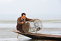 Fisherman checks the catch accomplished with a different kind of net.