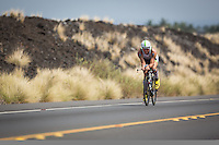 Frederik Van Lierde climbs the Queen K highway on the bike at the 2013 Ironman World Championship in Kailua-Kona, Hawaii on October 12, 2013.