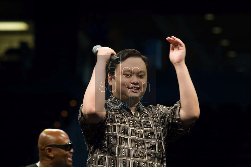 "Former ""American Idol"" contestant William Hung sings during a Dreams N2 Reality show and casting call at Philips Arena in Atlanta on Saturday, August 4, 2007. People offered their auditions in hopes of gaining spots on game shows and others in the reality TV genre. Former ""Real World"" star Syrus sits behind."
