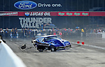 Jun. 18, 2011; Bristol, TN, USA: NHRA pro mod driver Roger Burgess loses control and crashes after winning his first round race during eliminations at the Thunder Valley Nationals at Bristol Dragway. Mandatory Credit: Mark J. Rebilas-