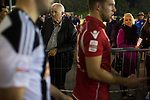 Connah's Quay Nomads 1 Llandudno 1, 20/09/2016. Deeside Stadium, Welsh Premier League. A spectator watching the players coming out of the dressing rooms after half-time at the Deeside Stadium as Connah's Quay Nomads (in red) played Llandudno in a Welsh Premier League match. Both clubs represented Wales in the 2016-17 Europa League, the first time either had competed in European competition. The match ended in a 1-1 draw, watched by 181 spectators. Photo by Colin McPherson.