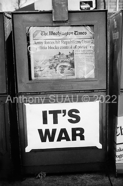 Washington, DC.USA.March 25, 2003..American Newspaper boxes advertise the war in Iraq.