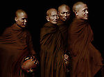 Monks return to their temple after collecting their daily alms (food) in Luang Prabang, Laos.
