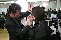 Yves Saint Laurent artist, applies makeup on woman, during the Makeup Show NYC, in the Metropolitan Pavilion, May 15 2011.