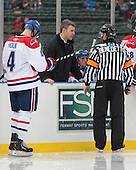 Joe Houk (UML - 4), Norm Bazin (UML - Head Coach), Tim Benedetto - The Northeastern University Huskies defeated the University of Massachusetts Lowell River Hawks 4-1 (EN) on Saturday, January 11, 2014, at Fenway Park in Boston, Massachusetts.