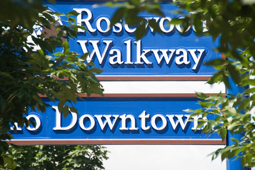 Signs for a pedestrian walkway in downtown Marquette Michigan.