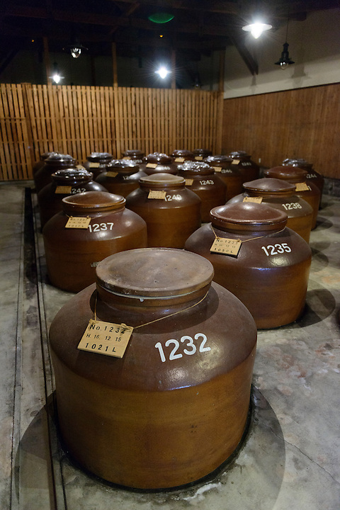 Shochu in storage. Sata Souji Shoten Shochu Distillery, Minami Kyushu, Kagoshima Pref, Japan, December 21, 2016. The Sata Souji Shoten Shochu Distillery makes shochu spirits from local sweet potatoes. In recent years the distillery has imported grappa, brandy, calvados stills from Europe to experiment with new distilling techniques. They have attracted considerable attention from the media and other distillers as leading innovators in their industry.