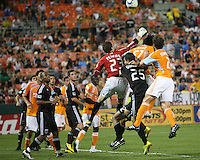 Troy Perkins #23 of D.C. United punches away from Adrian Seioux #51 of the Houston Dynamo during an MLS match at RFK Stadium in Washington D.C. on September  25 2010. Houston won 3-1.