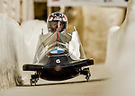 8 January 2016: Jamie Greubel Poser, piloting her 2-man bobsled for the United States of America, enters the Chicane straightaway on her second run, ending the day with a combined 2-run time of 1:53.48 and earning the gold medal at the BMW IBSF World Cup Championships at the Olympic Sports Track in Lake Placid, New York, USA. Mandatory Credit: Ed Wolfstein Photo *** RAW (NEF) Image File Available ***